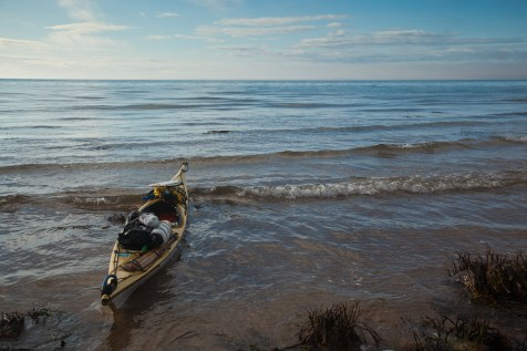 Preparing to paddle to the horizon