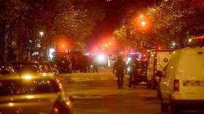 Policemen patrol the streets during gunfire near the Bataclan concert hall on November 13, 2015 in Paris