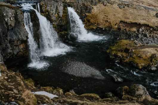 waterfalls cascading near the rocky field