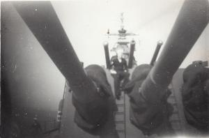 Bill McGee on the gun turret of the USS Fall River