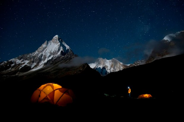 One last look before bed. Renan Ozturk checking out the stars above basecamp the night before the approach to the base of the route.  Copyright Jimmy Chin.