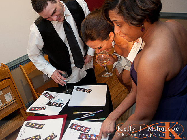 Bride & Groom looking over the ScrapBook their guests have been creating for them with Williamsburg Photo Booth