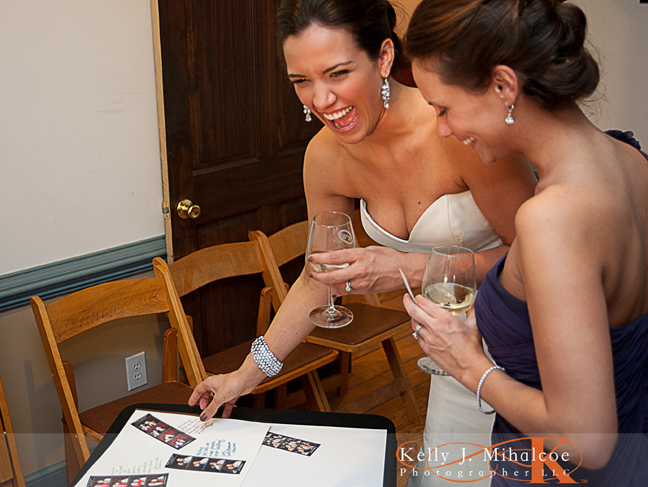 Bride laughing at some of the more enjoyable images in her ScrapBook from Williamsburg Photo Booth