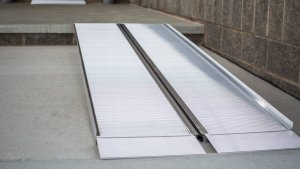 photo of a suitcase ramp - one type of portable wheelchair ramp supplied by Williams Lift