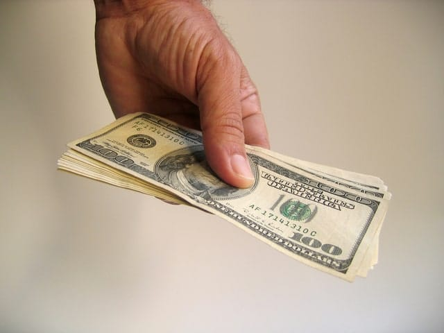Image of spending money on long term care insurance for elderly parents.