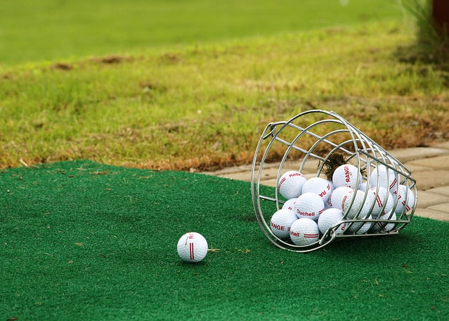 Image of a golf course and golf balls for an article about seniors and golf.