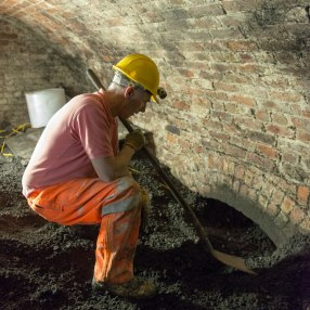The digging team at work uncovering a hidden passage.