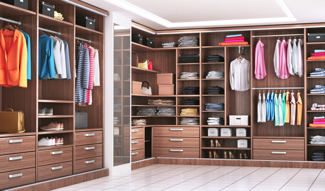 wooden melamine closet with hanging clothes and drawers
