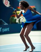 VENUS IN BLUE DRESS AND HEELS ON COURT