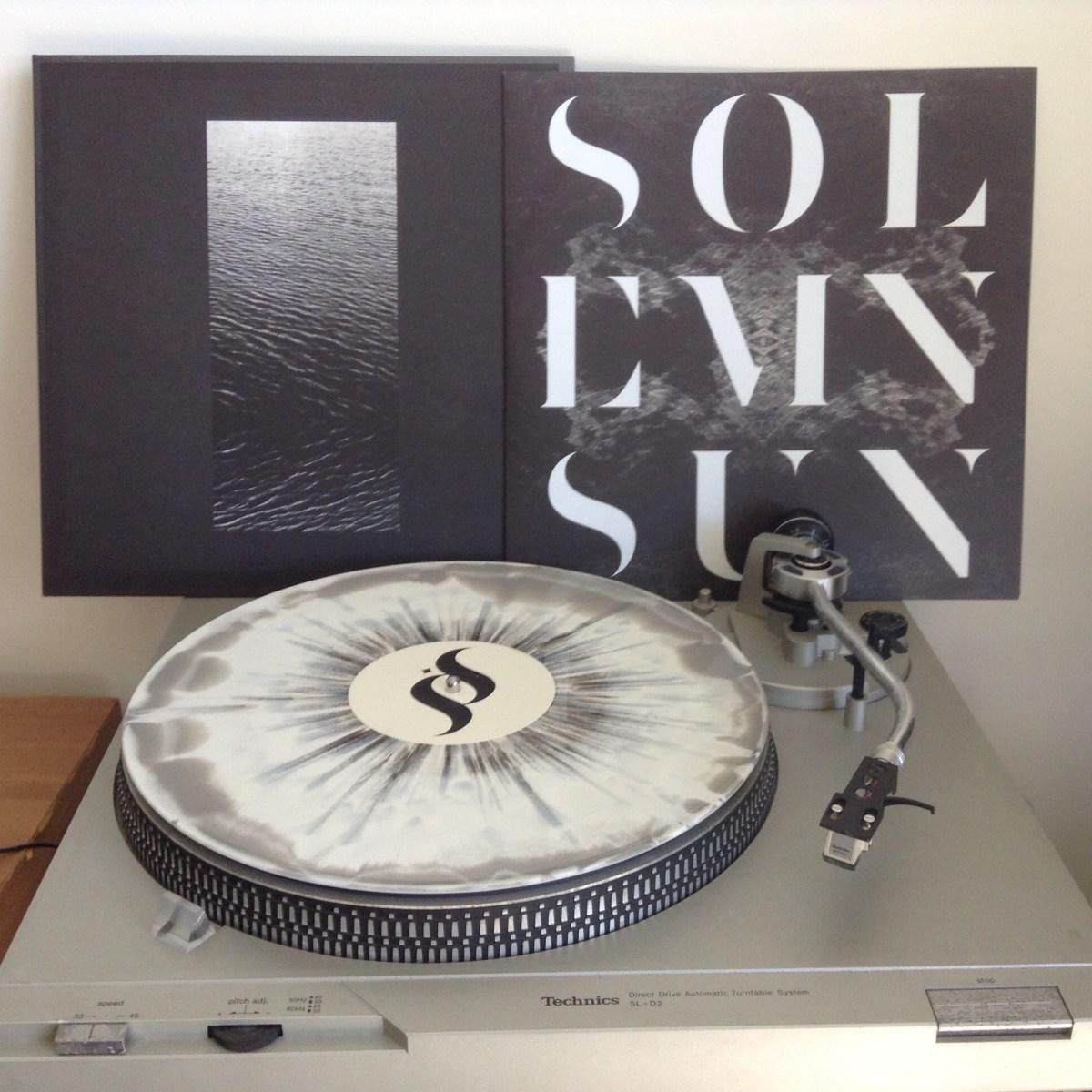 Solemn Sun Vinyl Record on Turntable