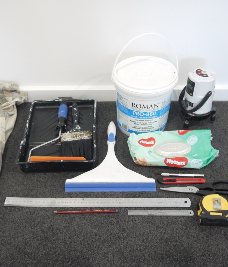 All the supplies needed to complete a vinyl heavy duty wallpaper wall covering installation. Heavy duty adhesive, laser level, steel ruler, stanley knife, tape measure, squeegie, baby wipes, paint roller and brush.
