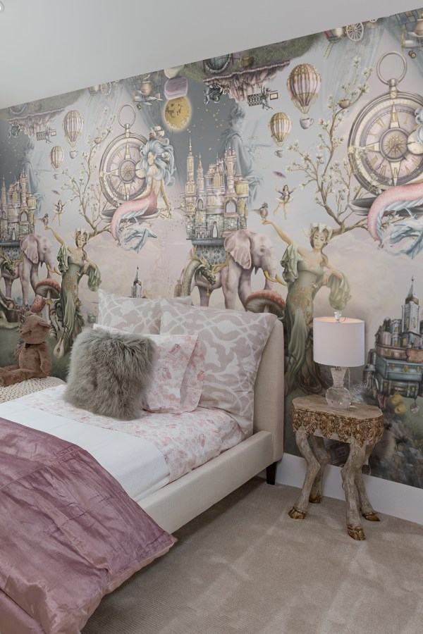 A gorgeous bedroom design with magical fairytale wallpaper mural, in pink, grey, sage green, steel blue and more.