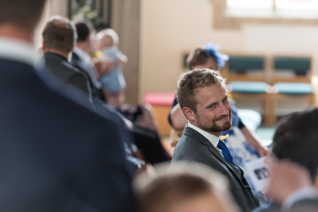 groom waiting in church