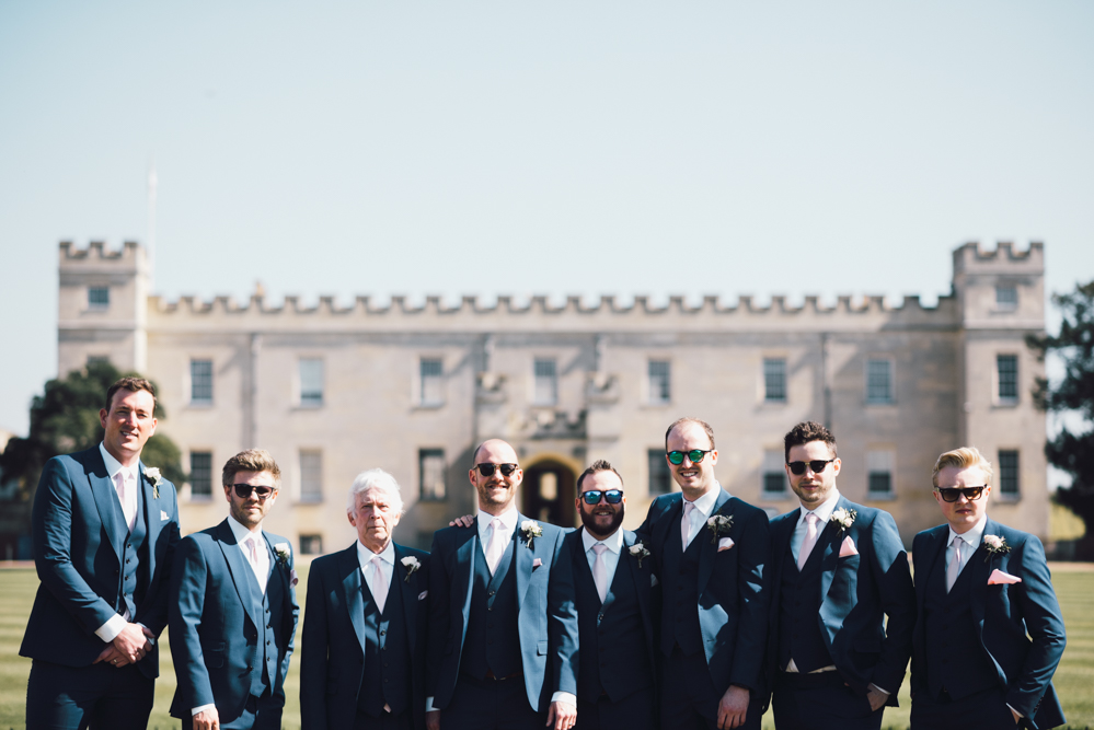 Groomsmen stand in front of Syon Park wedding photography