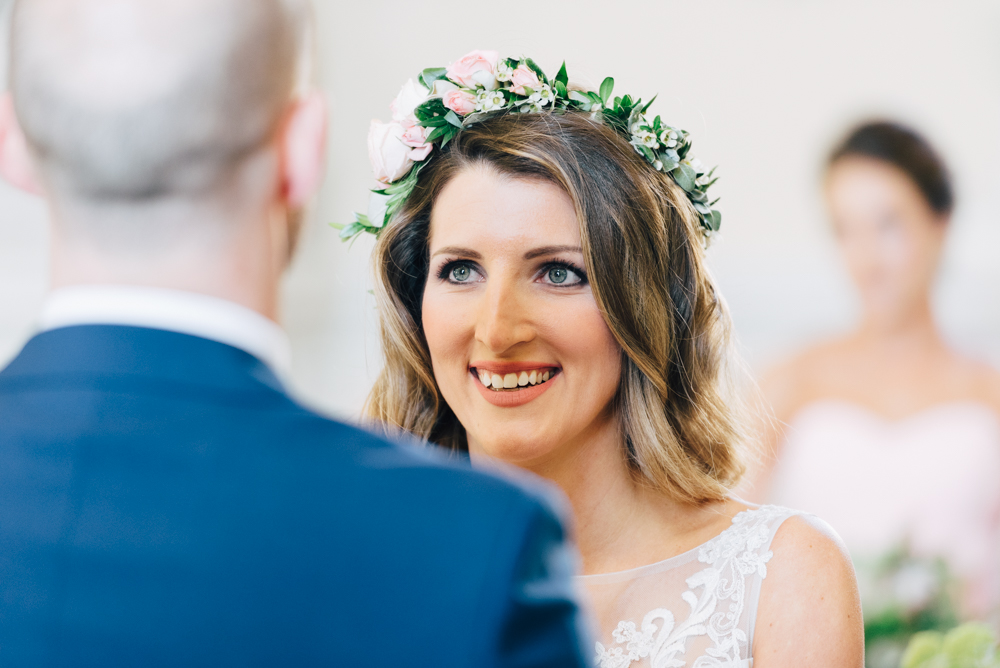 Bride smiles at groom during her wedding at Syon Park