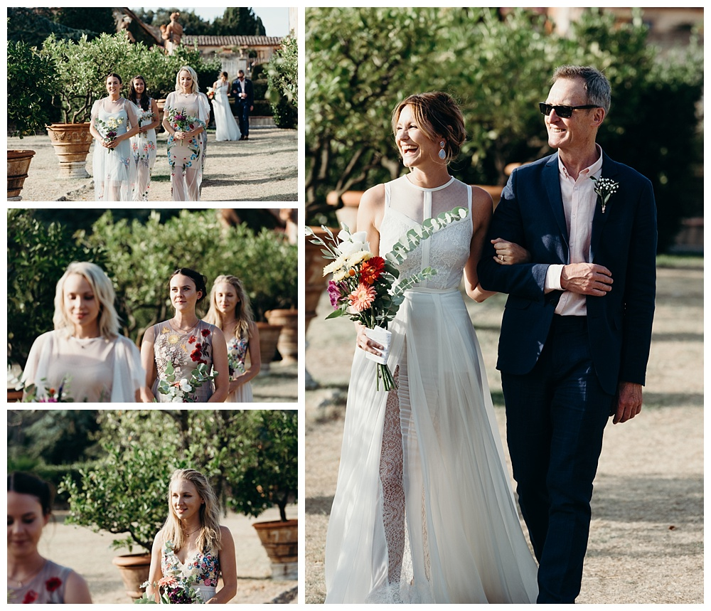 Bride and bridesmaids enter wedding ceremony outside at tuscany wedding