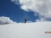 Lee walking over snow on ridge