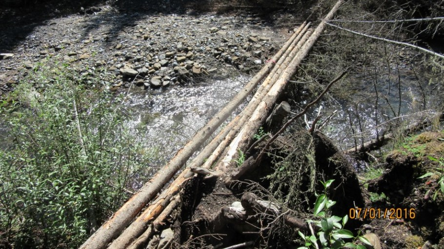 Second bridge.Three logs guess they ran out of funds