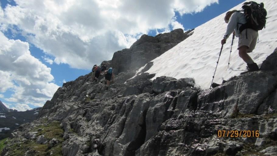 Cutting across to Burstall Pass under Snow Peak. Snow still in the way June 29