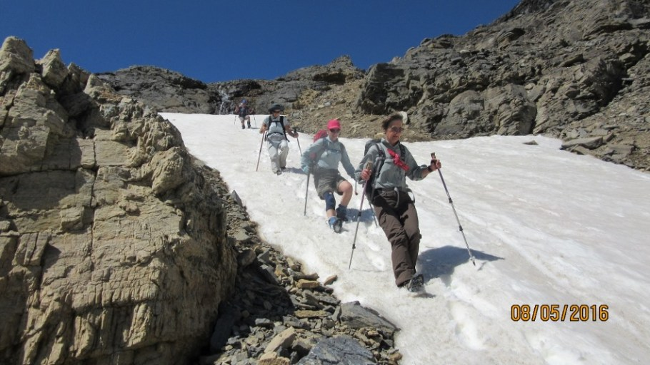 Kicking in the heals to descend the snow patch in the gully