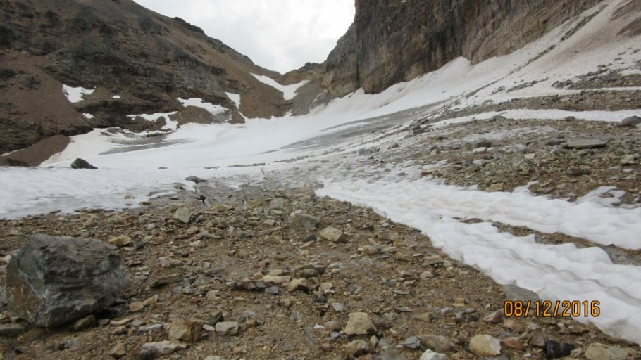 Rocks on the ice Opabin Pass behind