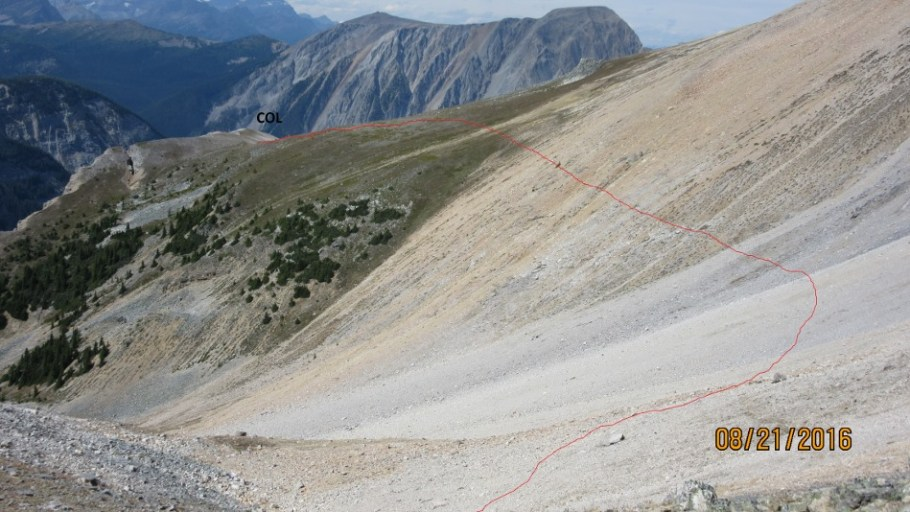 There is a faint trail from the col and it comes out below the rock outcrop