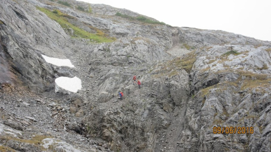Trail goes through this rock wall to Aster Lake