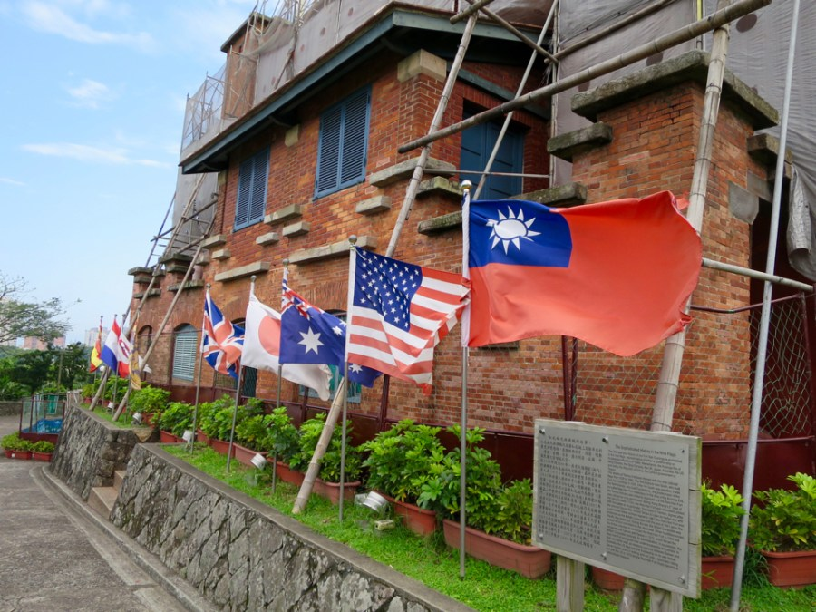 Various flags representing the history of Fort San Domingo