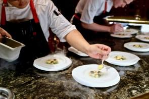 é by José Andrés - Chefs plating the Asparragos Escabeche