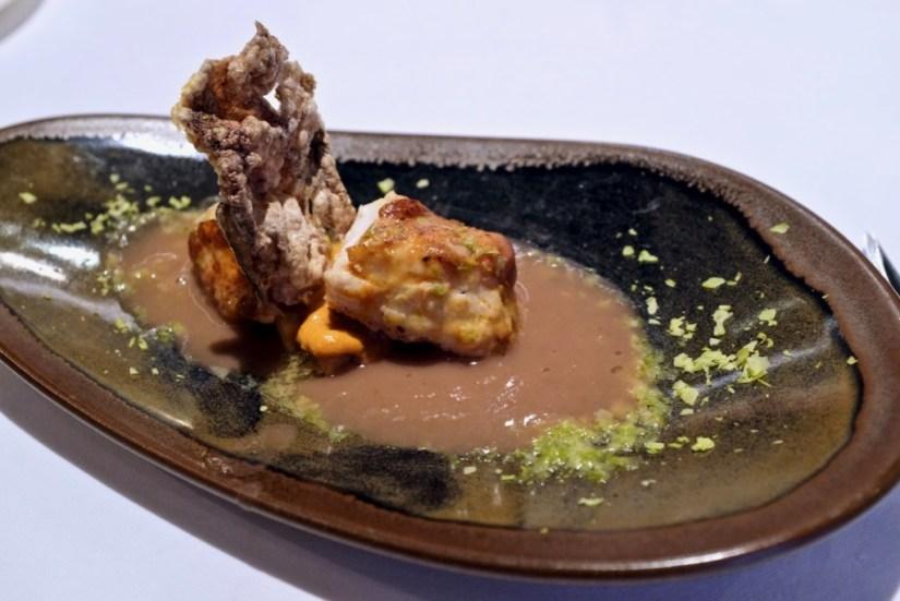 Arzak - Dark Monkfish, pistachio shavings, potato souffle skin, black bean sauce.
