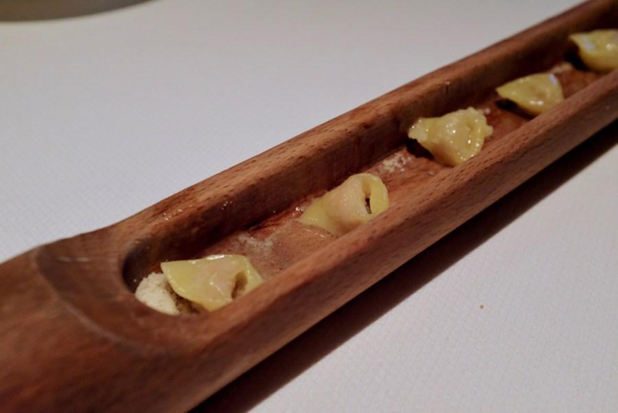 Quince SF - Pork Tortellini Fatto a Mano, Parmesan Reggiano. Served in vintage pasta roller.