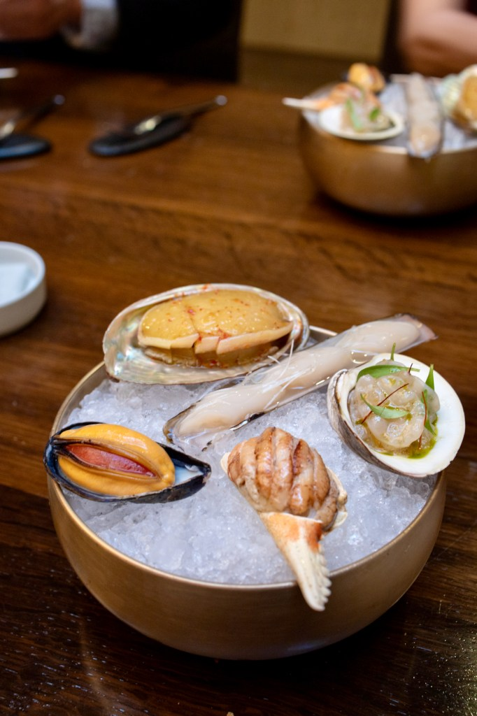 Benu - Abalone with chili, razor calm, geoduck, dungeness crab salad, mussel stuffed with mussel tartare