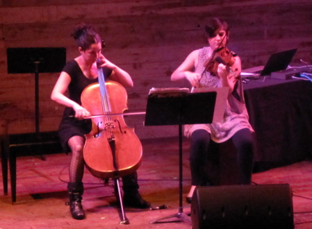"""Nadia Sirota (right) and Clarice Jensen performing Nico Muhly's  """"Duet No. 1, Chorale Pointing Downwards"""" at Galapagos Art Space."""