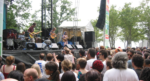 The Feelies spent last Fourth of July in Battery Park in NYC, opening for Sonic Youth. That's Yo La Tengo's Ira Kaplan in the lower right corner, just to the right of North Jersey singer-songwriter Ed Seifert in the white T-Shirt. (Copyright 2008, Steven P. Marsh)