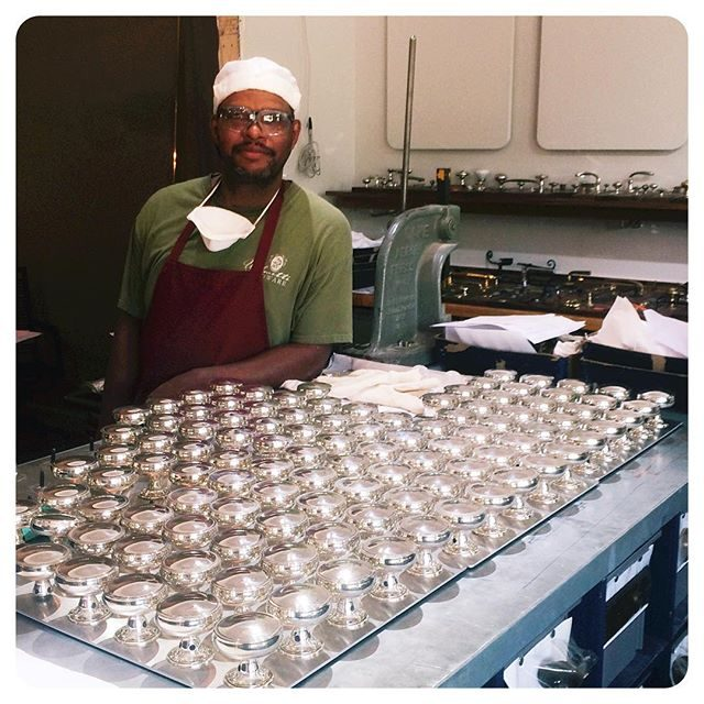 Here is James standing proud by the gorgeous silver knobs he finished for a new home in Wayzata, MN