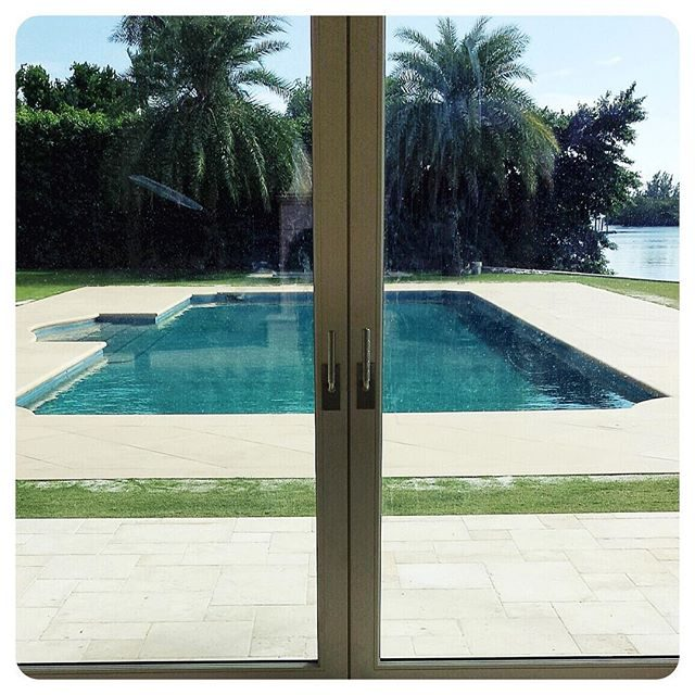waldorf lever on a pair of lift and slide glass doors in Palm Beach, Florida