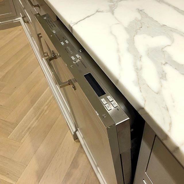 dishwasher trim strip in polished nickel to protect cabinet edge