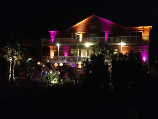 beach house event lighting purple orange ocean isle beach nc