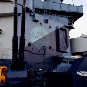 logo monogram color projection fro event onboard battleship wilmington nc