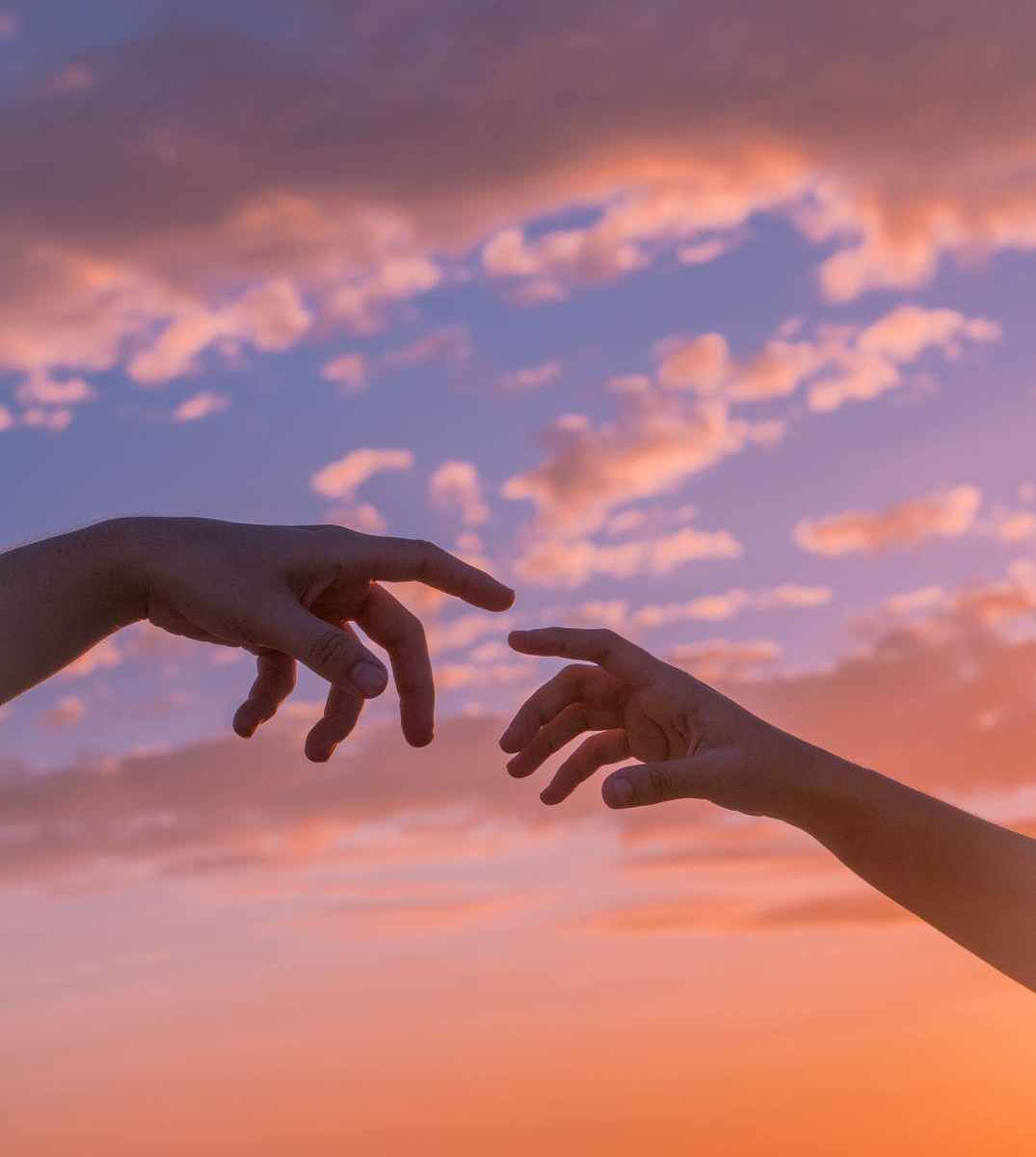 people reaching hands to each other
