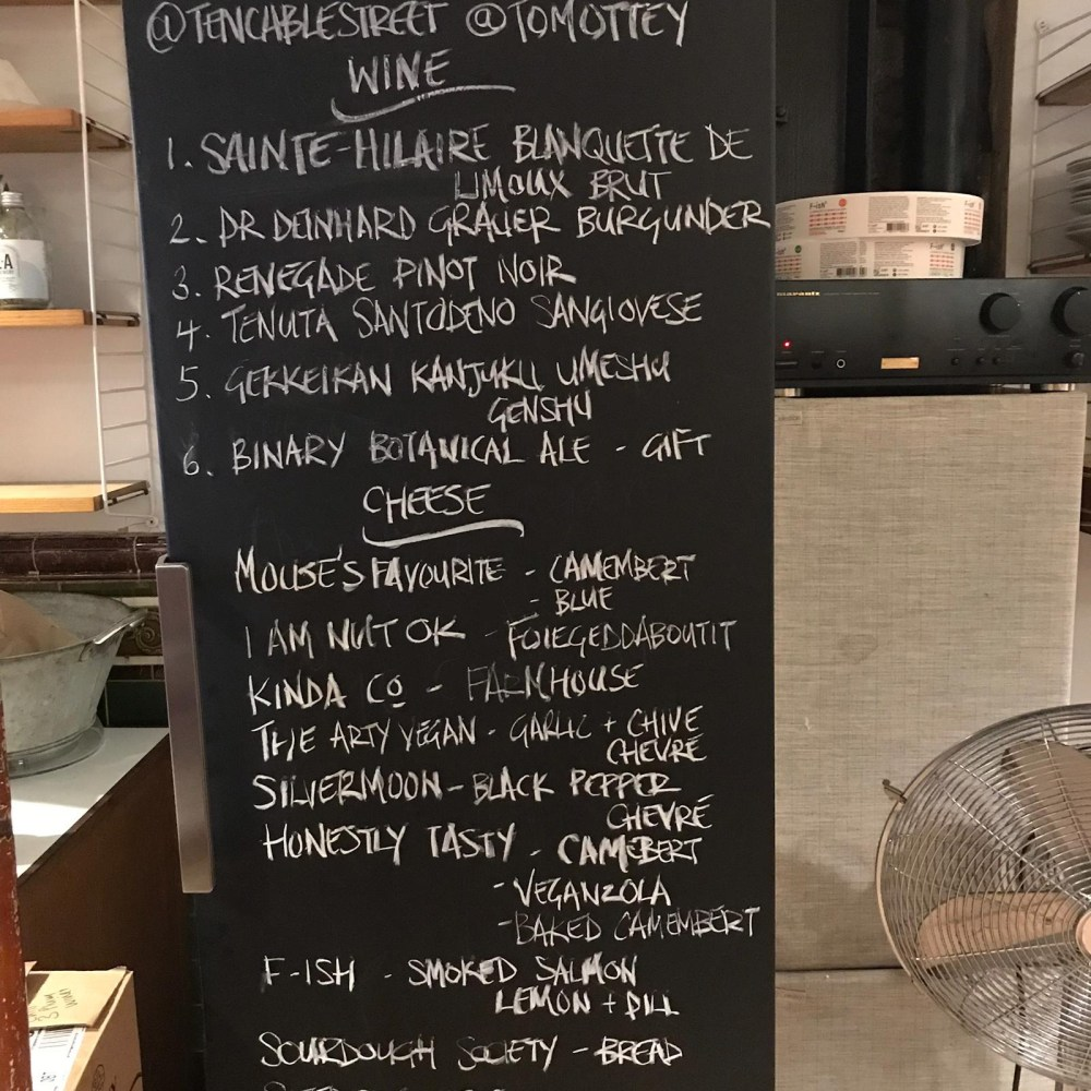 Blackboard with the lists of wine and cheeses for the evening