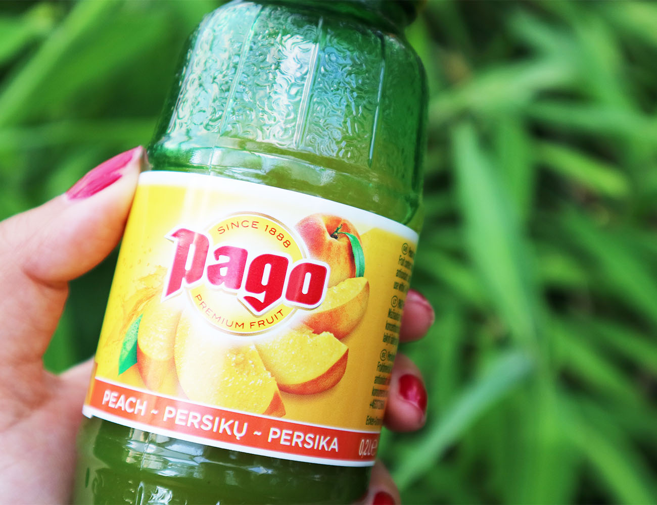 A bottle of Pago peach flavoured fruit juice