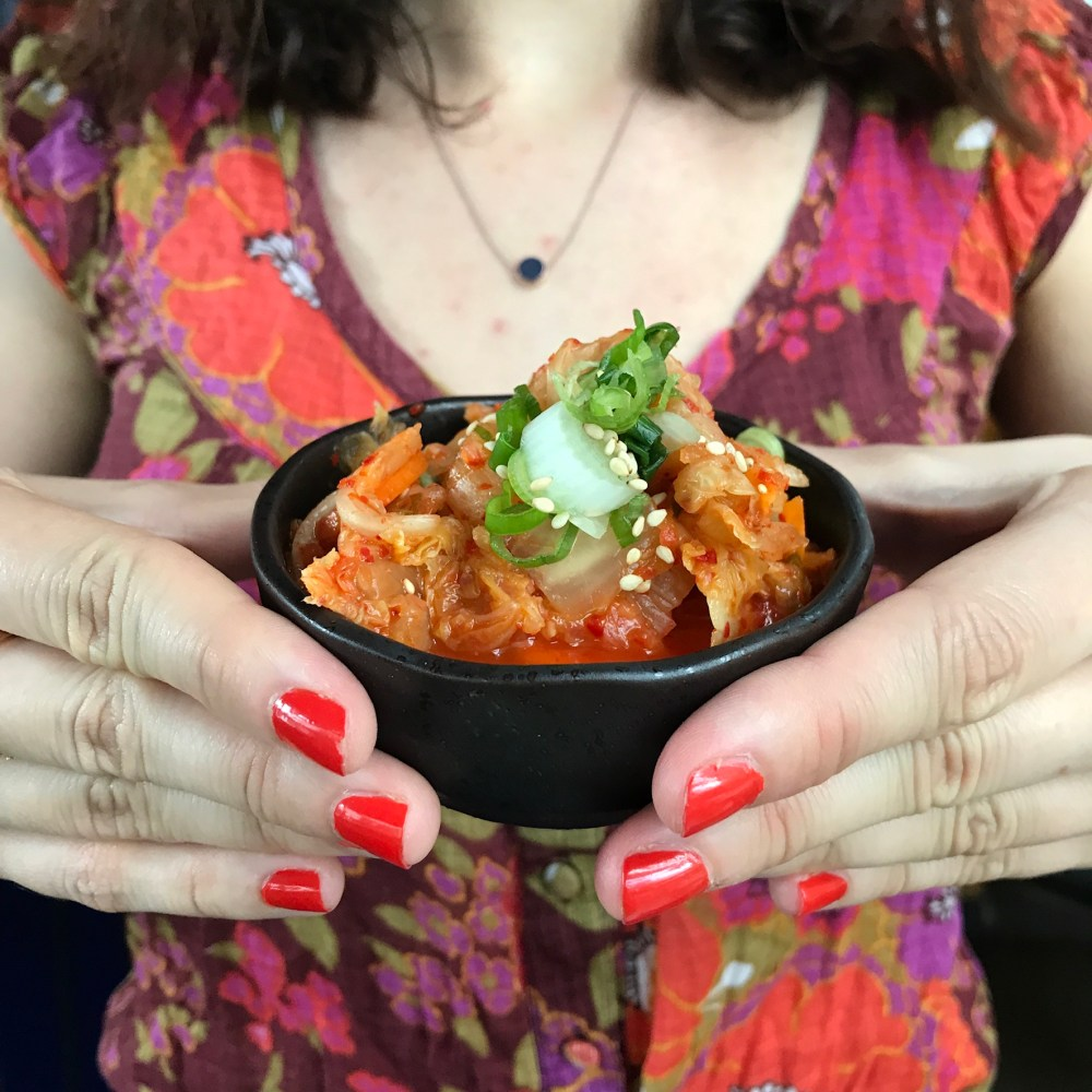 Claire holding the kimchi