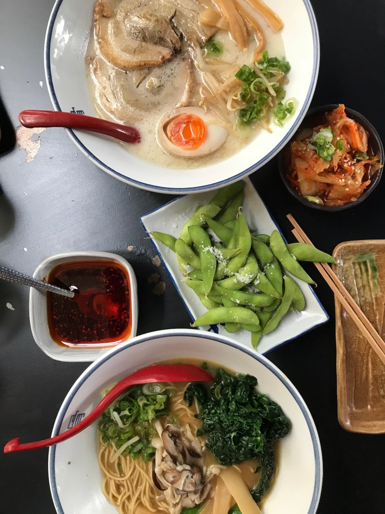 A flat lay of two ramen bowels, and the starters