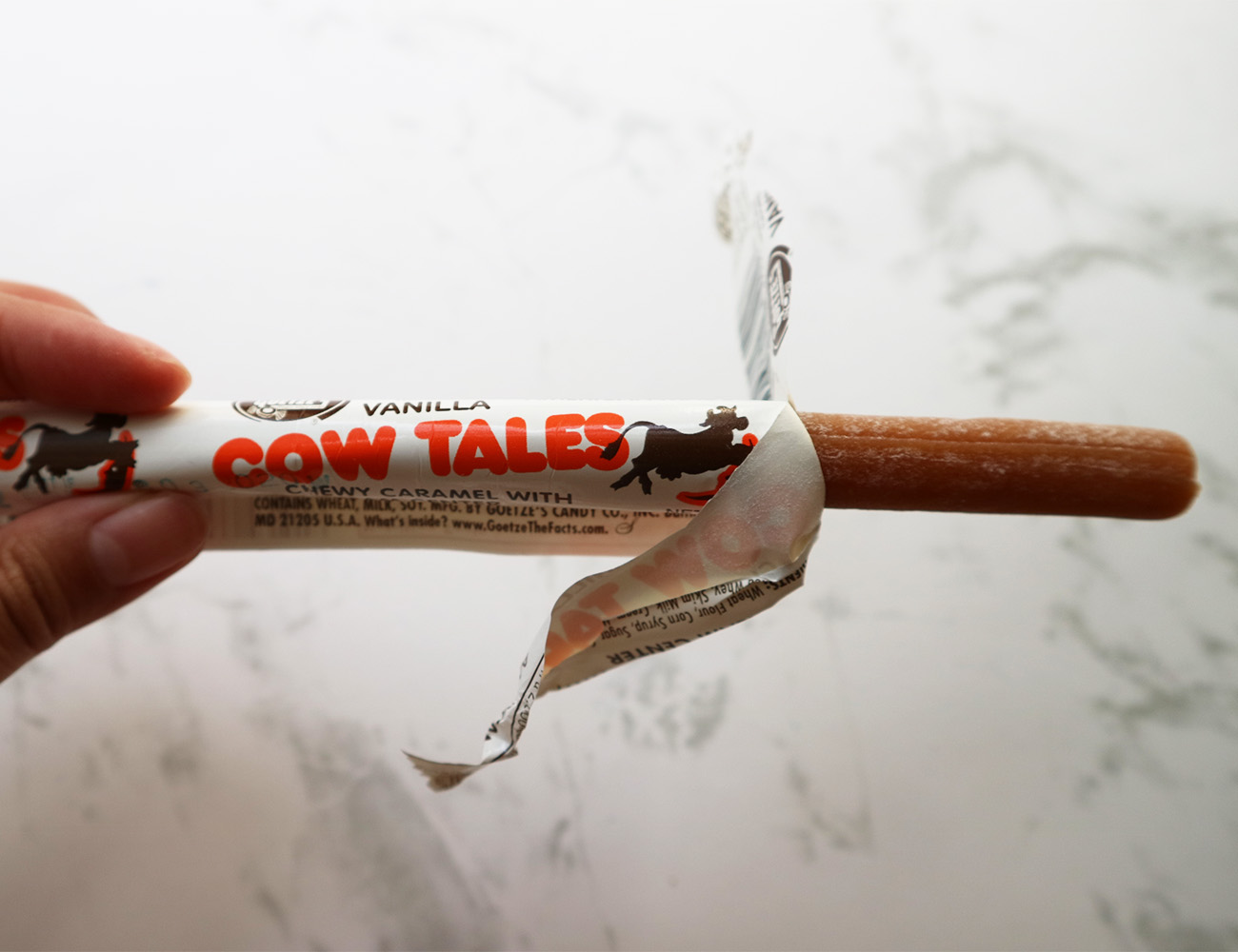 Cow Tales the wrapper is half way down from the sweet