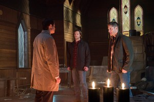 """Supernatural -- """"Hell's Angel"""" -- ImageSN1118A_0343.jpg -- Pictured (L-R): Misha Collins as Castiel, Jared Padalecki as Sam and Jensen Ackles as Dean -- Photo: Liane Hentscher /The CW -- © 2016 The CW Network, LLC. All Rights Reserved"""