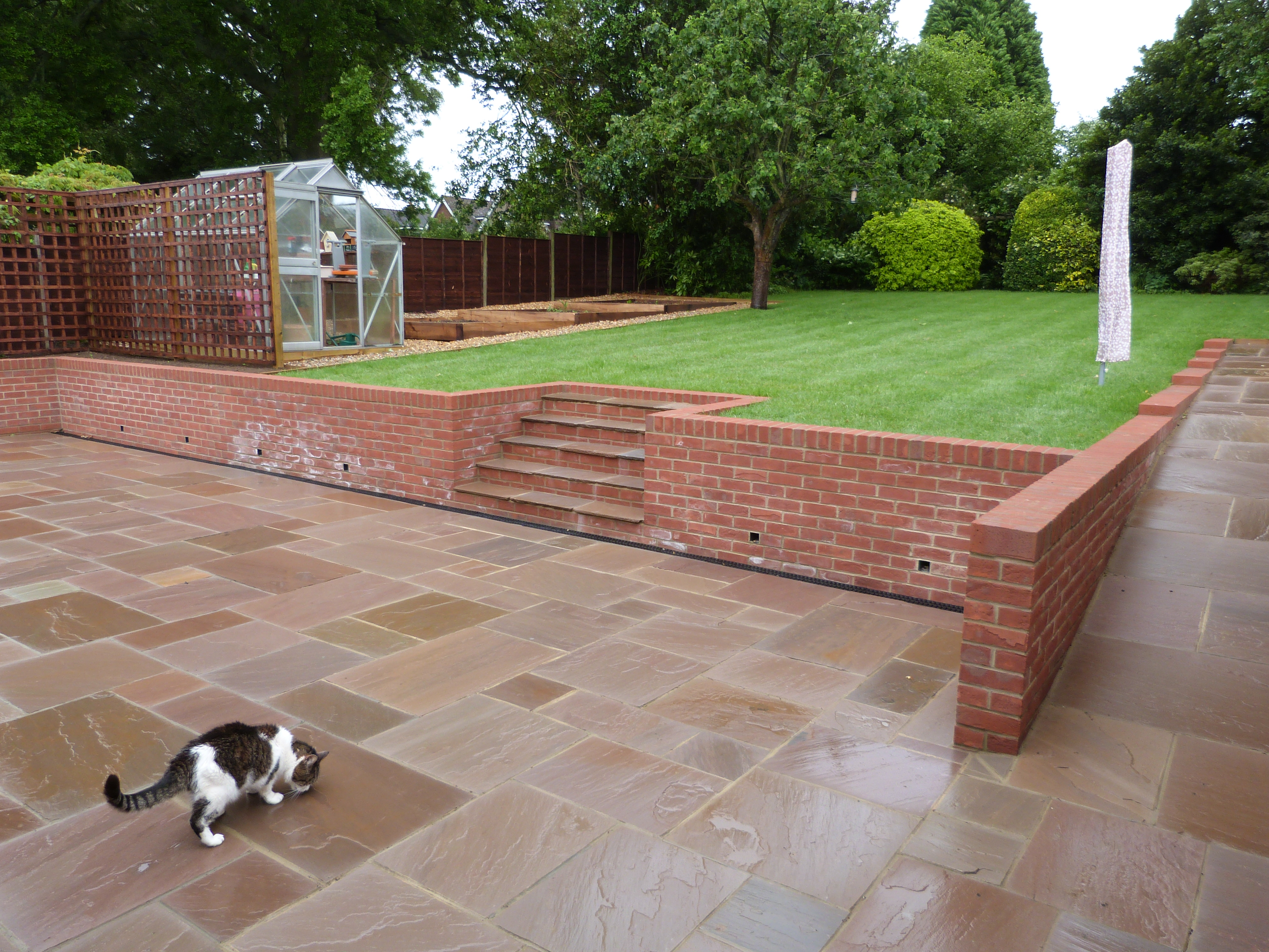 Sandstone Patio, Retaining Wall and lawn - Winchester ... on Patio Stone Wall Ideas  id=72509