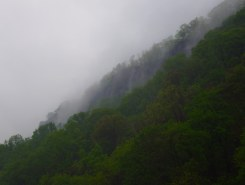 Overhead, the Palisades are steaming as the rain lets up