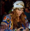 Gypsy consulting her oracle