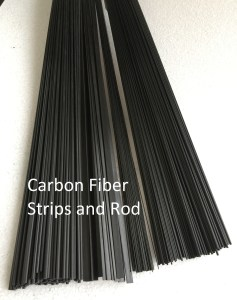 Assorted sizes of carbon fiber strips and rods.